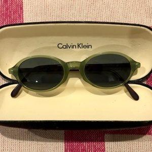 CALVIN KLEIN Clear Green Tortoise Oval Sunglasses